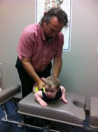 Dr. Mike adjusting Daniel